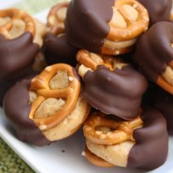 1 cup creamy peanut butter  2 tbsp softened butter  1/2 cup powdered sugar (maybe more)  3/4 cup brown sugar (maybe more)  Pretzels  1 bag  semi-sweet chocolate chips