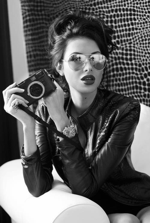 Chica con camara de fotos sensual