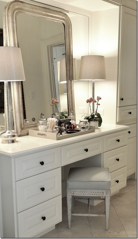 Don't want to -- or if renting, can't -- do away with the big mirror in the bathroom or dressing room, layer with a framed mirror. In this case, a Louis Philippe style mirror, my favorite style.
