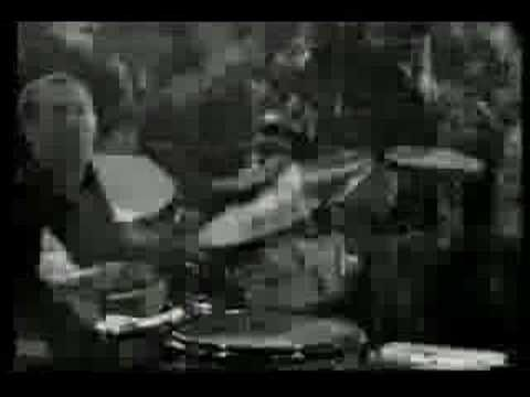 "The Monks- Complication (live on German TV)- note the banjo player on the right & lyrics that go ""people die for you, people kill for you!"""