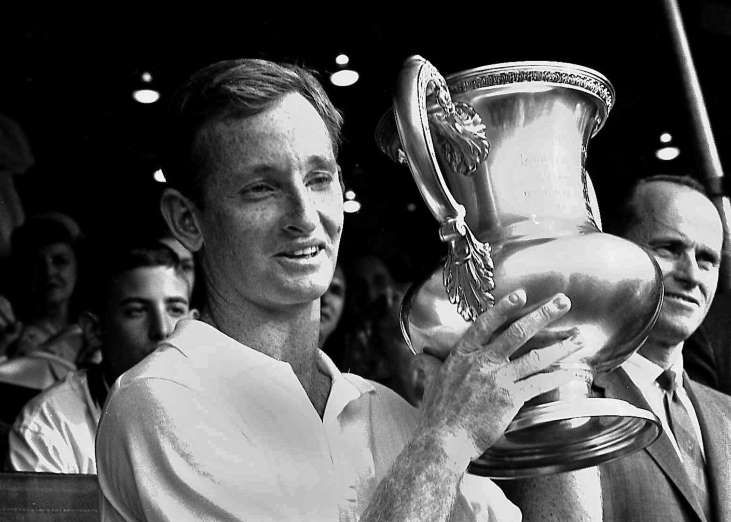 September 10,1962: ROD LAVER BECOMES FIRST MAN TO WIN GRAND SLAM  -   Australia's Rod Laver holds up trophy he received at the West Side Club, Forest Hills, N.Y. after beating Roy Emerson, also Australian, 6-2,6-4, 5-7,6-4, to win the mens singles title of the National Tennis Championships.