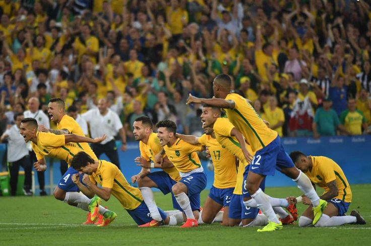 Brazil players celebrate after defeating Germany in the men's gold medal match during the Rio 2016 Summer Olympic Games at Maracana.   -  Best images from Aug. 20 at the Rio Olympics
