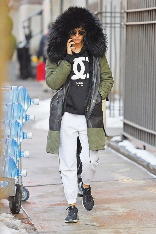 Style a parka with a sweatshirt and sweatpants look like Cara Delevingne.
