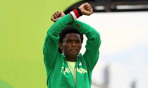 Medallist Feyisa Lilesa fails to return to Ethiopia after Olympics protest - Runner was not on board team plane despite assurances he would not be punished for taking a stand over political repression in his country - Lilesa crossed his arms as he finished the marathon and on the podium in a symbolic protest against the repressive Ethiopian regime.