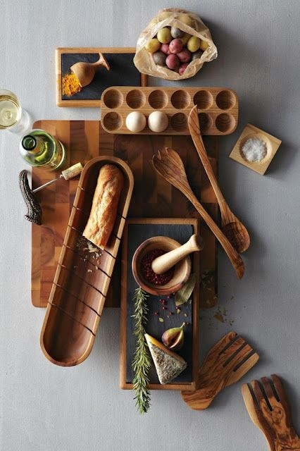 wood kitchen products. so in love with that wooden egg crate and the bread slicing bowl.