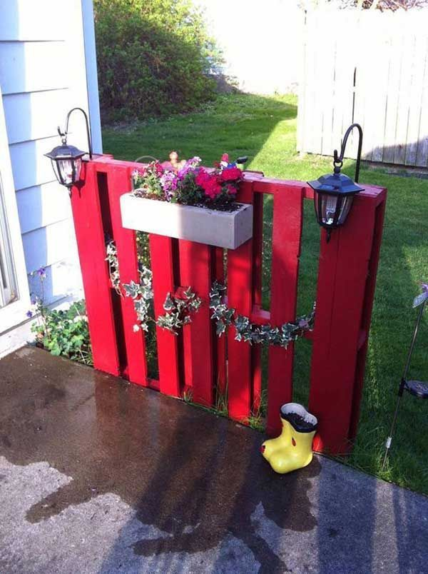 10. Red painted pallet fence decorated with box planter.
