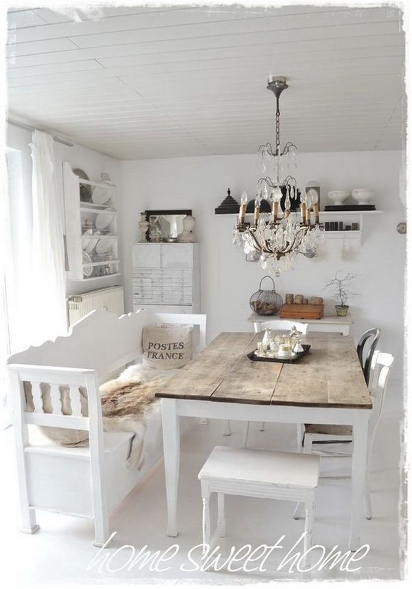 Whitewashed shabby chic dining room with a touch of rustic warm.