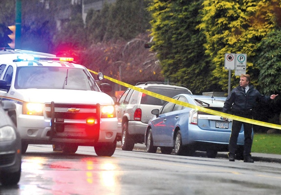 Police cordon off a portion of Chesterfield Avenue north of 14th Street Thursday afternoon after a fleeing suspect was seriously injured by a police dog.