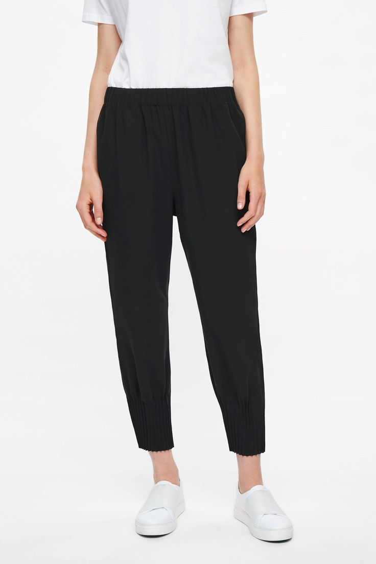 COS - Trousers with pleated hems in Black