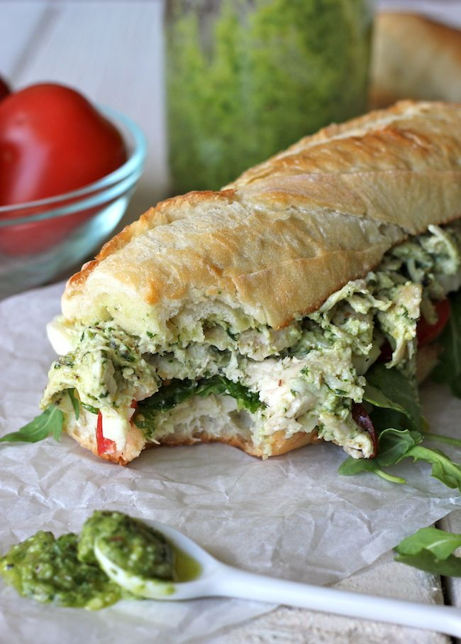 Chicken Pesto Sandwich on a freshly baked baguette with arugula, tomato, and thick mozzarella slices. Made in just 5 minutes!