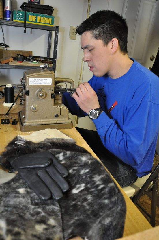 Jeremiah James learns to sew marine mammal furs at a workshop sponsored by the Sealaska Heritage Institute. (Photo courtesy Kathy Dye/Sealaska Heritage Institute)