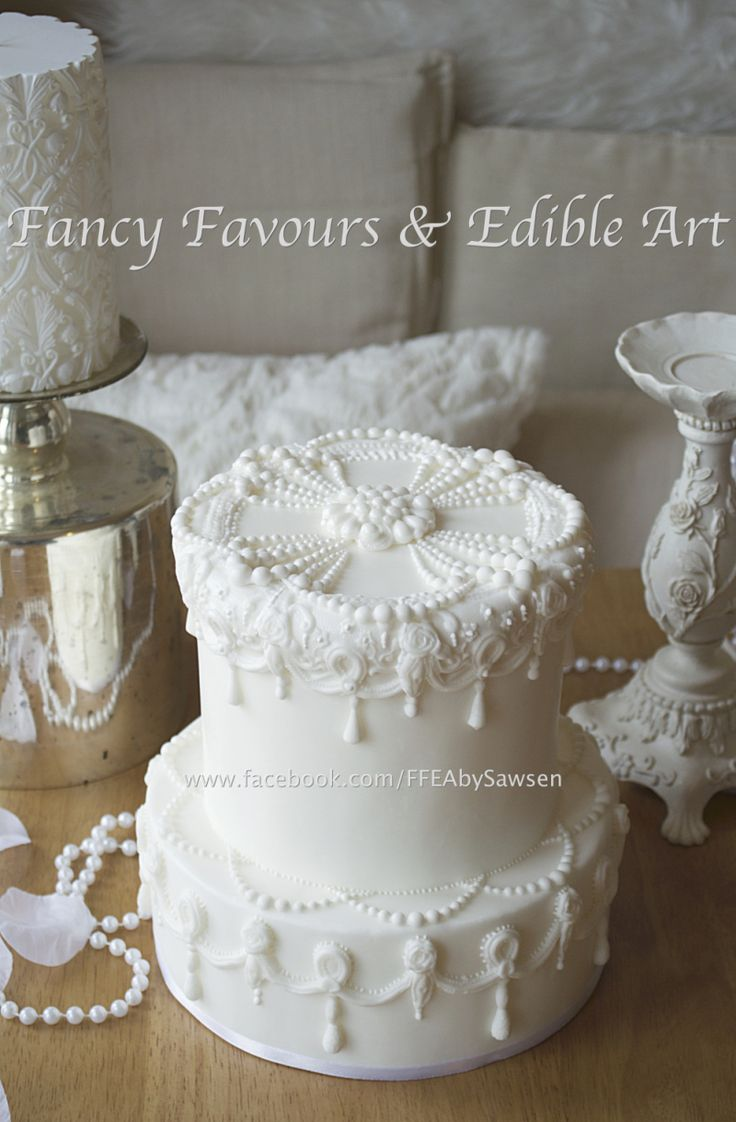 Vintage pearl traditional white on white wedding cake close up ...