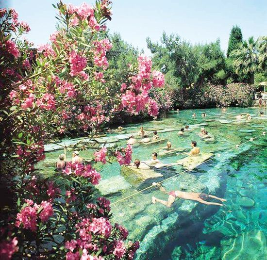 """Pools of Pamukkale Turkey - Meaning """"cotton castle"""" in Turkish, Pamukkale is a natural site in southwestern Turkey. Pamukkale's terraces are made of travertine, a sedimentary rock deposited by water from the hot springs."""