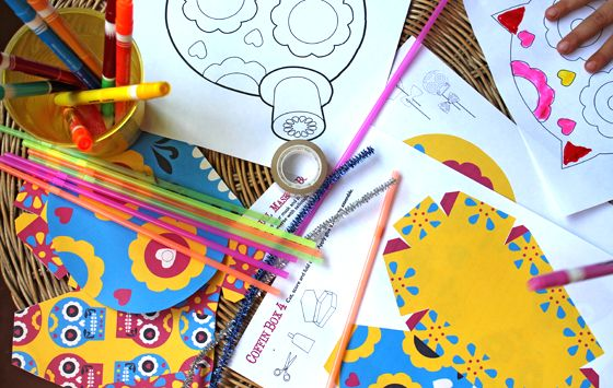 Day of the dead or el dia de los muertos ideas for an activity table at a party or fiesta. Coloring in pages, paper masks and activities - https://happythought.co.uk/day-of-the-dead/activity-table