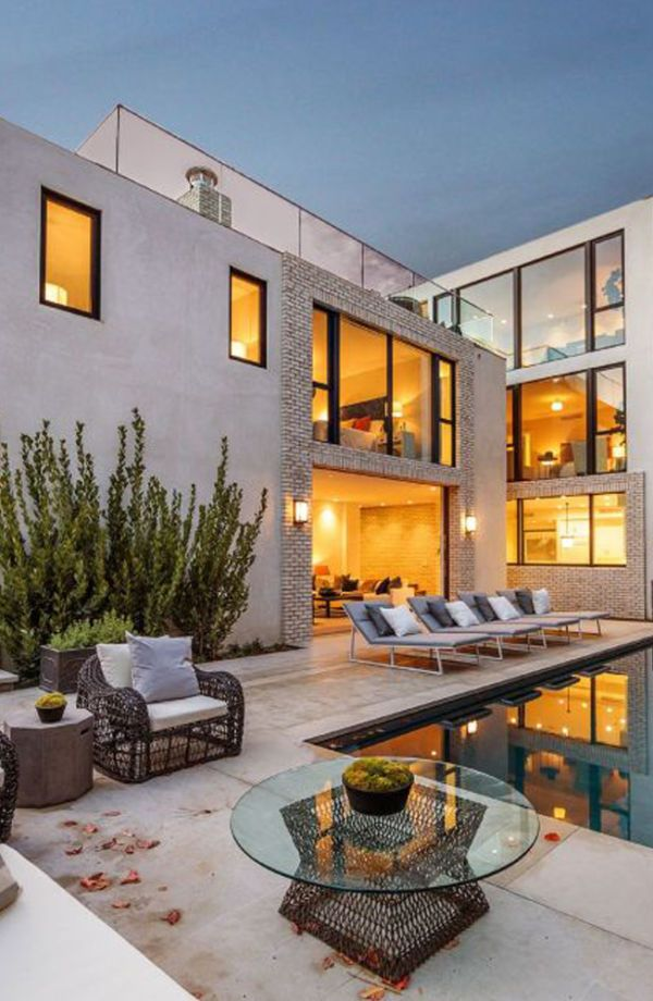 Kendall Jenner, acquiring a $6.5 million pad for herself in Hollywood, formerly occupied by Emily Blunt and John Krasinski. While it's oddly fascinating that celebs seem to love playing the house-swap game, we can't help but lust after this remarkable three-story, six-bedroom and five-bathroom home—complete with the most insane rooftop deck and pool overlooking the city of Angels.
