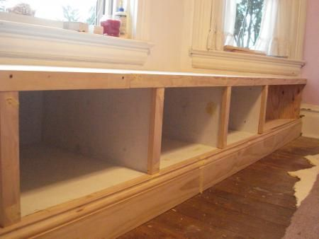 dying to build a window seat with built in cabinets/shelving in the living room