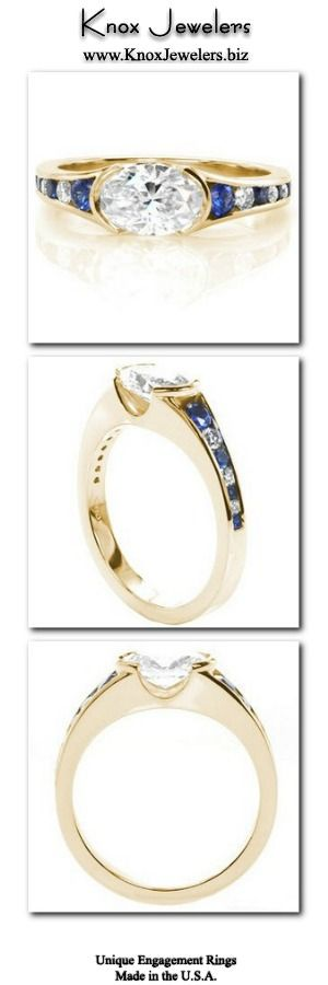 This engagement ring design is a contemporary setting showcasing a brilliant horizontal set 1.00 carat oval diamond shouldered on either side by a half bezel. The flared band features channel set blue sapphires and diamonds, placed every-other to create an eye catching pattern. This design can be made for any type, shape, or size center stone.From out of town? No problem. Check out our Try Before you Buy Program. Click on image for more info.#engagement #wedding #ring