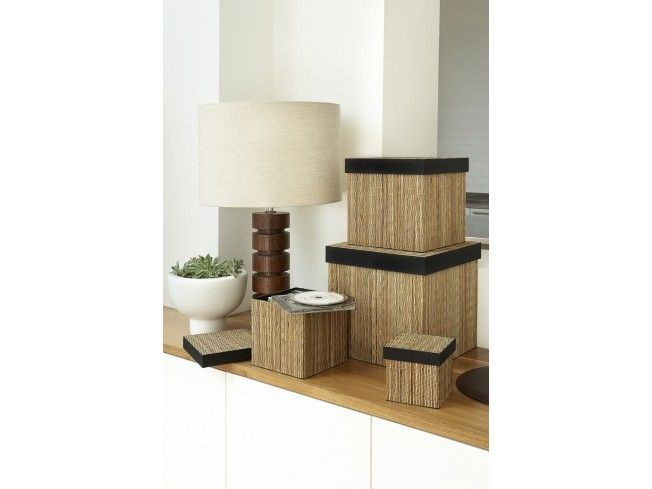 The layer of reed slivers stitched onto the surface of our square lidi box makes it incredibly sturdy as well as looking stylish. You can fill these storage boxes as full as you like and they will stack on each other without bowing. The black cotton lining in these square boxes and matching trim adds a luxurious touch and makes them eminently suitable for storing delicate items. Perfect storage for the Living Room.