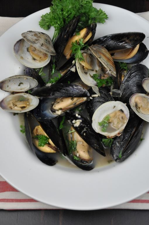 This is a quick and healthy recipe for Mussels and Clams in White Wine that anyone can make! You can also throw in some shrimp if you like! Easy Dinner!