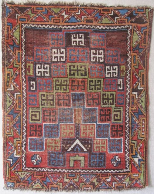 """Central Anatolian prayer rug (Karaman area?) c1870 with an original and creative rendering of ascending niches previously unknown to me. Camel hair wefting(dyed green in the center of the rug) with occasional shoots of undyed black wool. Size approx. 3'2""""x4'."""