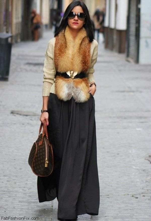 belted faux fur vest and black silky flowy full circle maxi skirt