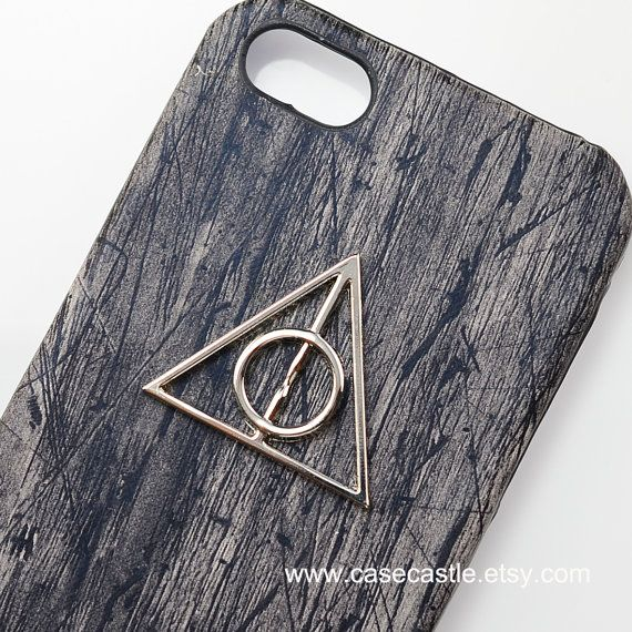 Silver Deathly Hallows grail Harry Potter on Wood Grain