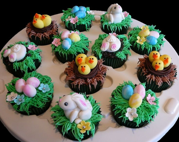 Easter Cupcakes featuring bunnies, chicks in nests and Easter eggs