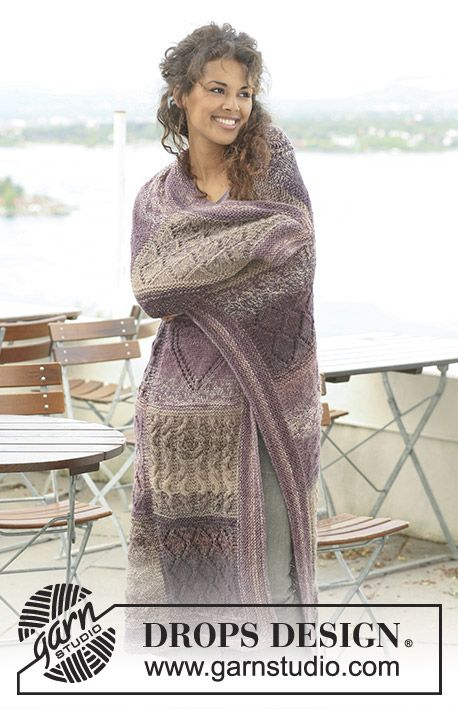 """Knitted DROPS blanket in """"Delight"""" and """"Alpaca"""" with squares in different textured patterns."""
