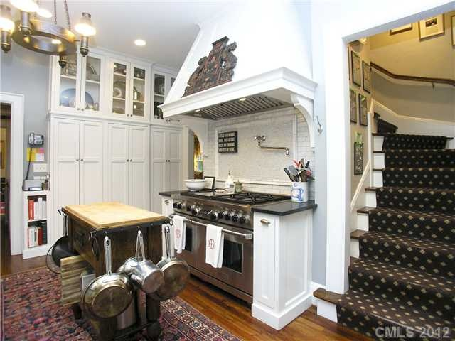 Pin serves as reminder of liking enclosed staircase off kitchen-with runner