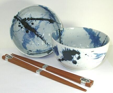 Blue Sumi Noodle Bowls by Uncommon Treasures. $24.95. Blue Sumi Noodle Bowls for Two ~ with splashes of navy blue and light blue against a creamy white back ground. Each bowl is approximately 5 inches in diameter and 3 inches tall with 2 pair of chopsticks. Comes in a gift box. Handcrafted in Japan.. Save 29%!