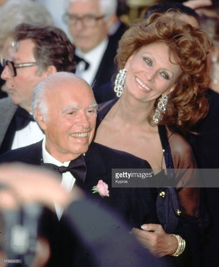 Italian film producer Carlo Ponti  with his wife, actress Sophia Loren, actually married twice in 1957, then remarried 1966 'til his death in 2007. Married for over 41 yrs.