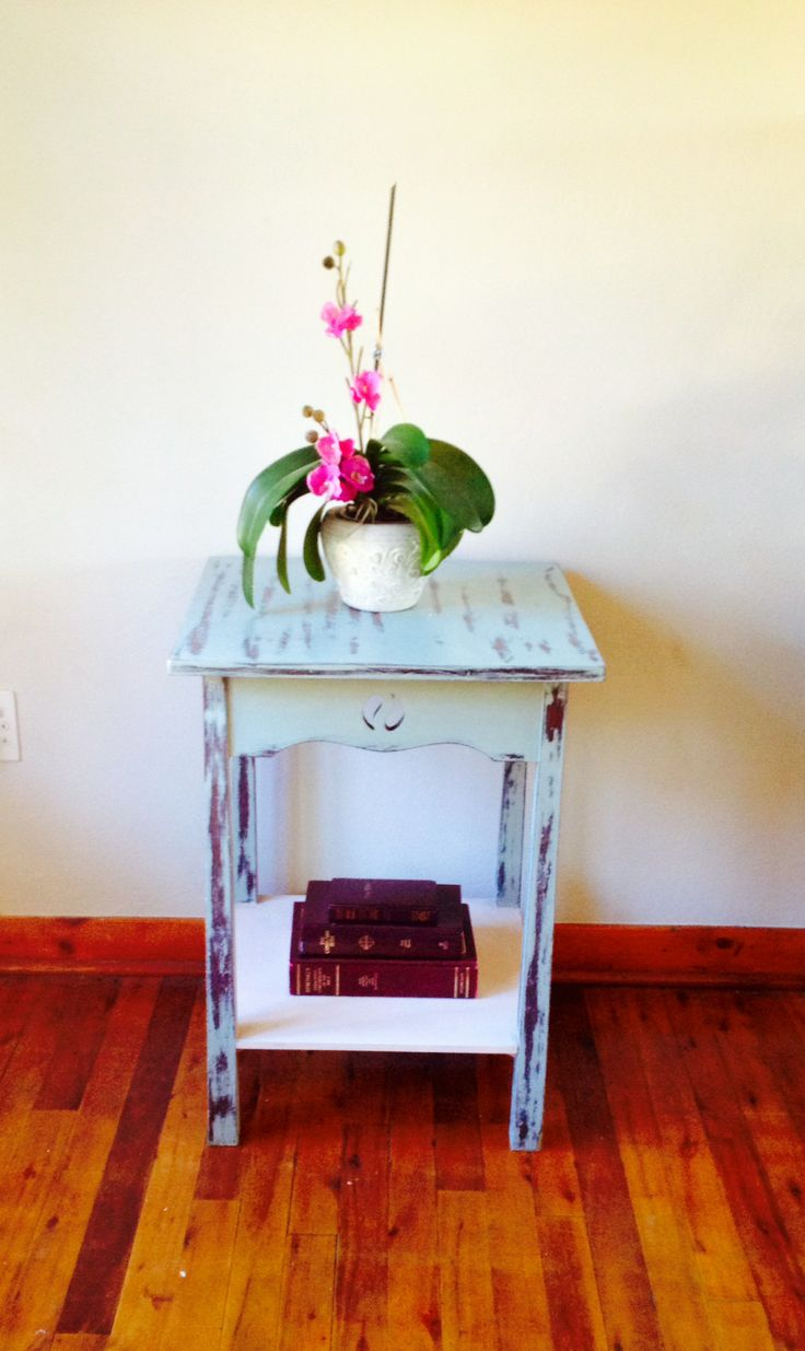 This solid wood table is made from oak wood with a small open carving in each of the panels. It has been restored with chalk paint in light grey.  The bottom shelf has been painted in a pale pink to bring in a nice contrasting colour.  The table has been distressed to give it some character and to create a shabby chic look. - See more at: http://www.artesense.co.za/pSKU162/Shabby-Chic-Distressed-WoodenTable.aspx#sthash.kKhK6lbu.dpuf