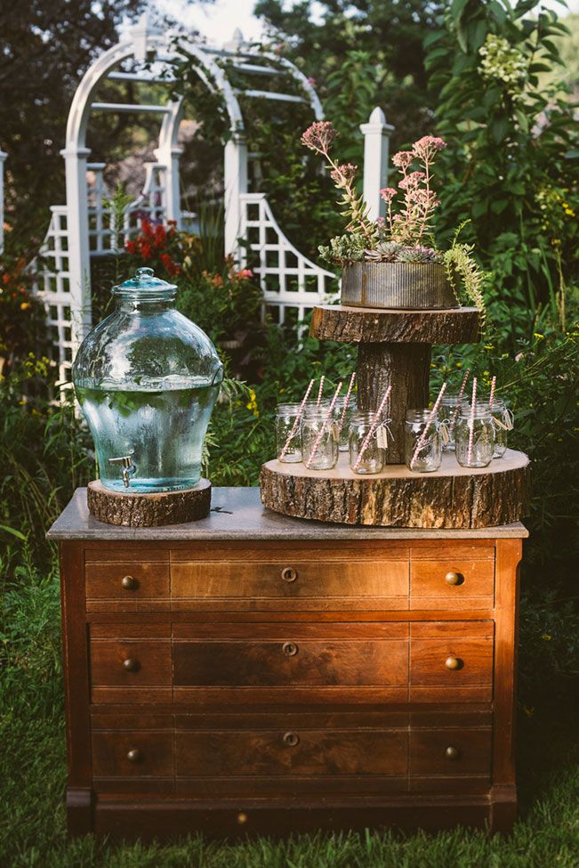 Raw wood beverage display, great for guests! Bohemian Chic Backyard Garden Wedding With Vintage Detailing   Photograph by Suzuran Photography & Styling by McPherson Events & Design