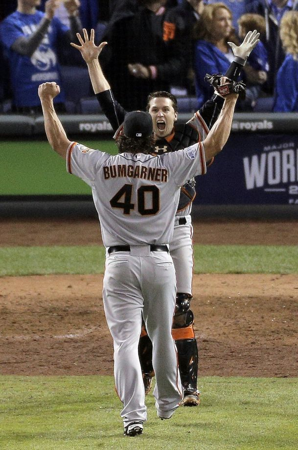 Giants Madison Bumgarner and Buster Posey celebrate after the Giants make the final out of the game, winning game seven of the World Series against the Kansas City Royals at Kauffman Stadium in Kansas City, Missouri, on Wednesday Oct. 29, 2014. Photo: Carlos Avila Gonzalez, The Chronicle