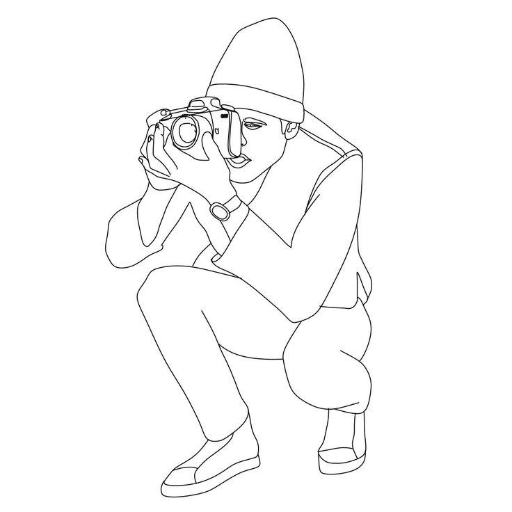 Man crouching taking a photo