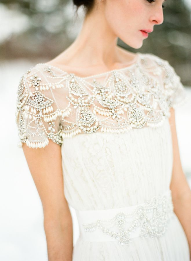 Gorgeous beaded winter wedding dress: http://www.stylemepretty.com/2015/12/06/snow-filled-winter-wedding-inspiration/ | Photography: Lindsay Madden - http://lindsaymaddenphotography.com/