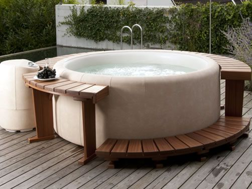 The Softub T-220 Four Person Spa.   Please call us for the best pricing rather than place an order for a Softub Spa over the web.  (805) 654-9000.  If you live in California's 805 area code, we are your local Softub dealer. If you need to find your local dealer anywhere else, you can use Softub's Local Dealer Finder.