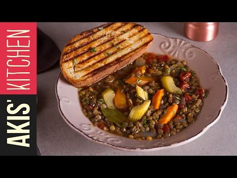 Lentil Soup  | Akis Petretzikis 250 g lentils 2 tablespoons olive oil 1 onion, medium 2 carrots 2 celery stalks 2 cloves of garlic 2 bay leaves pinch of chili flakes 1 teaspoon cumin 1 can chopped tomatoes 1 vegetable bouillon cube diluted in 1 ½ liters water or 1 ½ liters vegetables stock 1 teaspoon salt