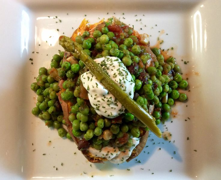 One small roasted sweet potato, split, then layered with plain Greek yogurt, then peas mixed with corn & bean salsa, a dollop of plain Greek yogurt & a pickled asparagus spear.