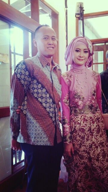 Wearing kebaya and batik