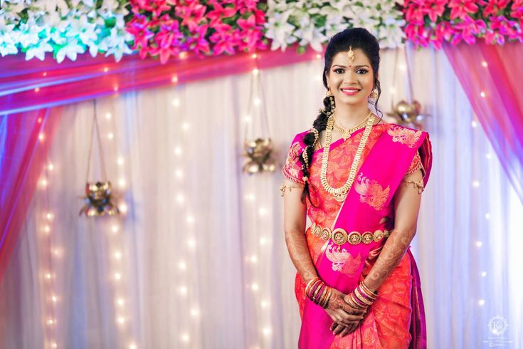 beautiful pink and orange coloured saree paired beautifully with the theme of their wedding