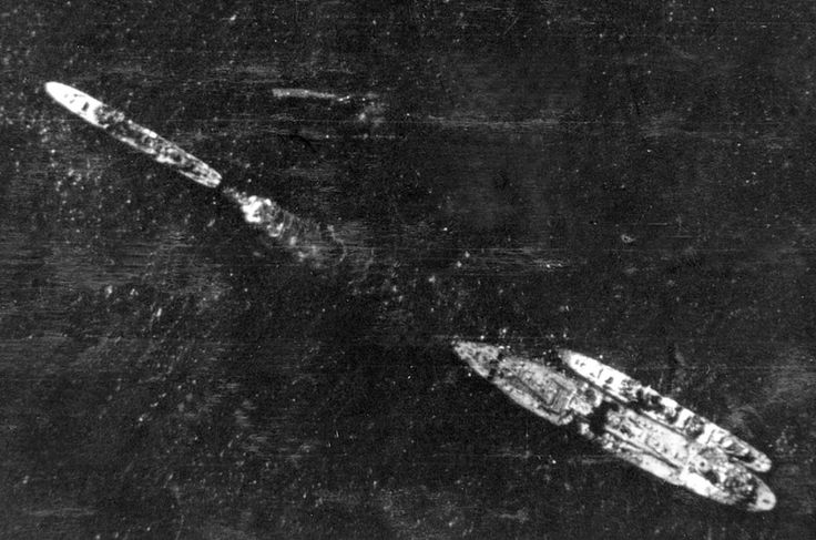 H.M.S Ledbury ahead of The Ohio. The Ohio is now in critical condition and is being towed to Malta.