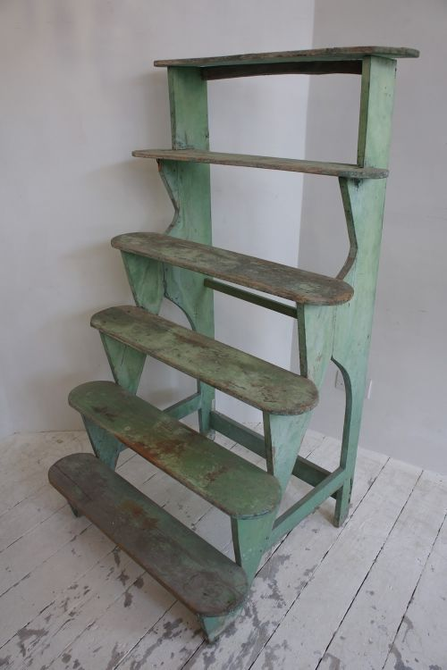 Antique French plant stand £365.00 This is a stunning and rare late 1800s French plant stand designed for use in the conservatory. With the original worn and chippy green paint and fantastic proportions, this is ideal for displaying your prize blooms!