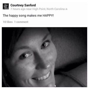 Posting to Facebook while driving appears to have played a role in an American woman's fatal car crash.