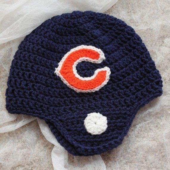 NFL Football Crochet hat - *Inspiration* I will be making one of these for the Bills, I think I will use felt to create the logo on the side and stripes going down the middle. I think a standard double crochet hat with ear flaps will work for this.