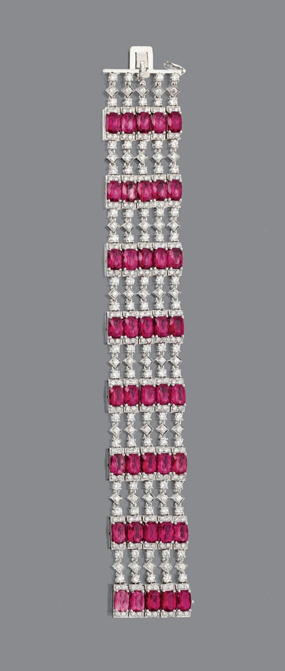 RUBELLITE AND DIAMOND BRACELET. The flexible multi-row strap set with 40 cushion-shaped rubellites joined by segments of chain set with numerous round diamonds weighing approximately 10.70 carats, mounted in 18 karat white gold, length 7 inches.