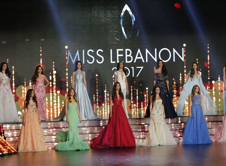 Contestants performing on a stage (AFP).  Lebanese singer Carole Samaha performs on a stage during the Miss Lebanon 2017 beauty pageant at Casino Du Liban in Jounieh, north of Beirut, on September 24, 2017. (AFP)   Newly crowned Miss Lebanon 2017 Berla Halo reacts after being elected at Casino...