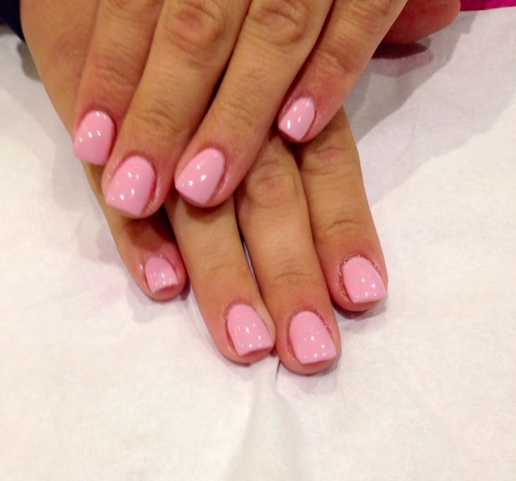 Short pink acrylic nails, perfect length for those on a computer all day