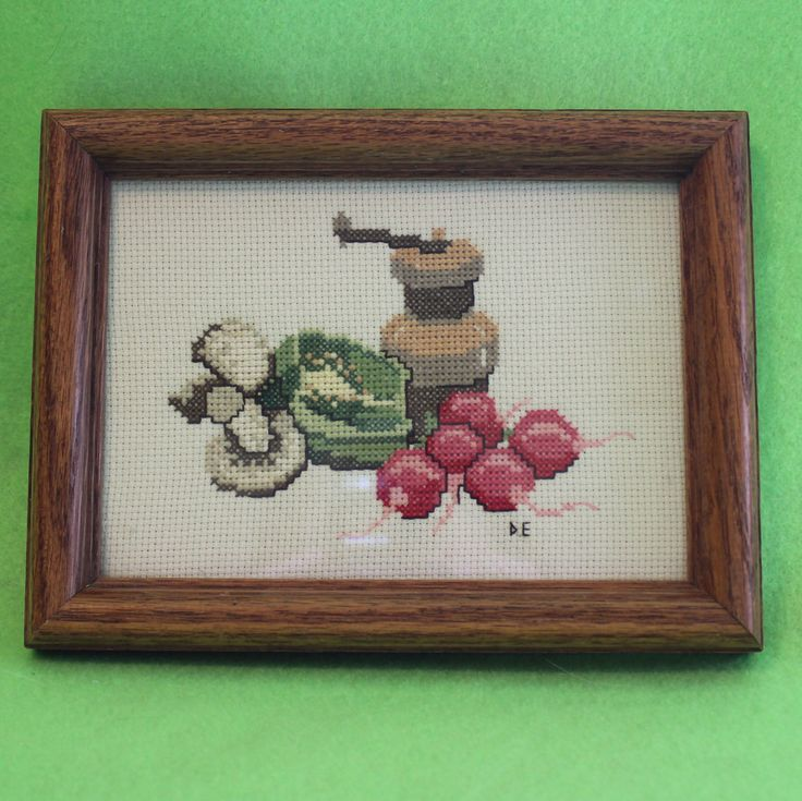 Needlepoint picture of mushrooms, lettuce, radishes and pepper mill $10.00