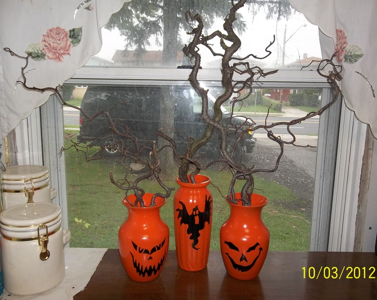 Amvets thrift store vases, spray paint, landscape clippings....Equals my version of the painted Halloween vases. Pumpkins for my window with no worry about spoiling or fruit flies!